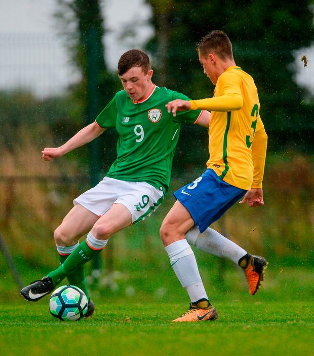 Conor Carty of Republic of Ireland in action against Gabriel Noga of Brazil. Photo by Piaras Ó Mídheach/Sportsfile