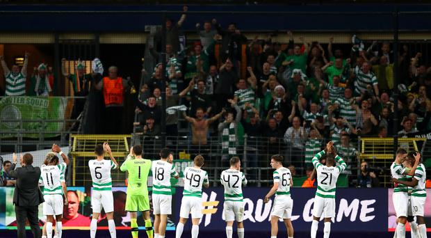 Celtic players applaud fans following victory the UEFA Champions League group B match between RSC Anderlecht and Celtic FC at Constant Vanden Stock Stadium on September 27, 2017 in Brussels, Belgium. (Photo by Dean Mouhtaropoulos/Getty Images)
