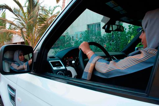 A Saudi woman drives her car along a street in the Saudi coastal city of Jeddah, yesterday. Photo: Getty Images