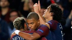 Paris Saint-Germain's Edinson Cavani celebrates scoring their second goal against Bayern Munich with Kylian Mbappe and Neymar. Photo: REUTERS/Charles Platiau