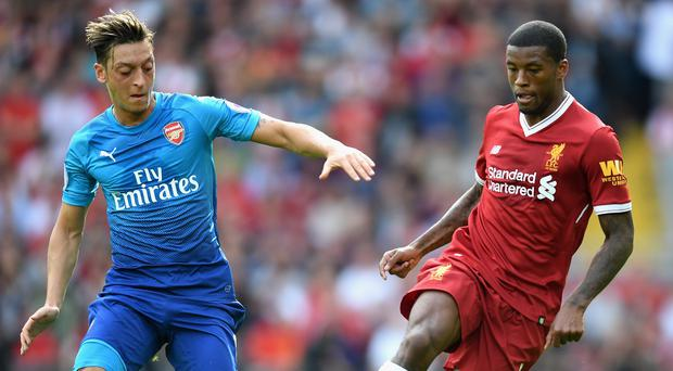 Arsenal's Mesut Ozil and Georginio Wijnaldum of Liverpool battle for possession when the two teams met in August. Photo: Michael Regan/Getty Images
