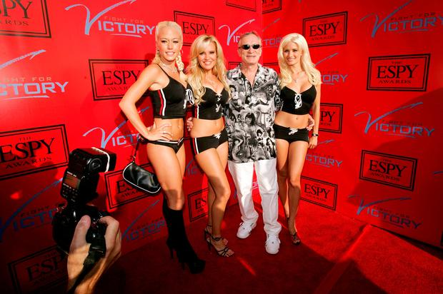 Playboy magazine founder Hugh Hefner (C) arrives with friends for an ESPY Awards pre-party at the Playboy Mansion in Beverly Hills, California in. REUTERS/Robert Galbraith/File Photo