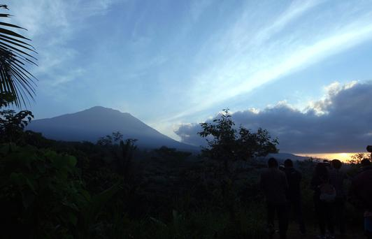 Mount Agung is seen at sunrise from an observation point which is about 12 kilometer (7.4 miles) away from the volcano in Karangasem, Bali, Indonesia, Thursday, Sept. 28, 2017.
