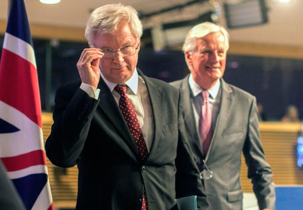 EU chief Brexit negotiator Michel Barnier, right, and British Secretary of State for Exiting the European Union David Davis leave after a media conference at EU headquarters