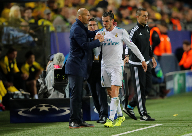 Zinedine Zidane shakes hands with Gareth Bale after he is substituted last Tuesday. Photo: Wolfgang Rattay