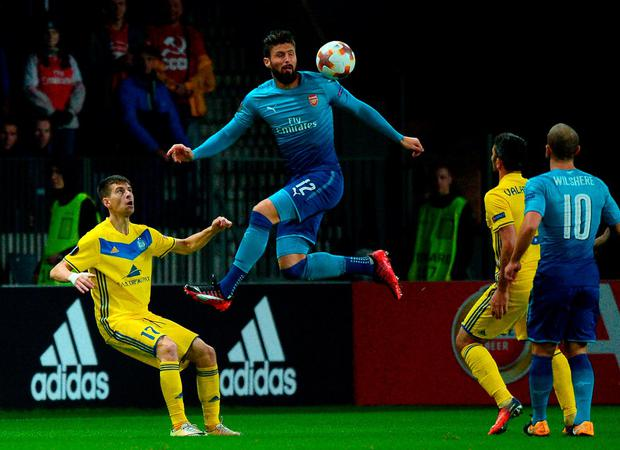 Olivier Giroud goes head and shoulders above the BATE Borisov defence in Minsk. Photo: Maxim Malinovsky/AFP/Getty Images