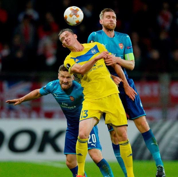 Arsenal's Per Mertesacker and Shkodran Mustafi in action with BATE Borisov's Mikalay Signevich. Photo: Adam Holt/Action Images via Reuters