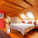 The timber-cladded master bedroom.