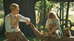Teddy bears' picnic: Domhnall Gleeson as AA Milne watches his son Christopher Robin playing with his stuffed toys
