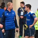 Leinster head coach Leo Cullen in conversation with Jonathan Sexton