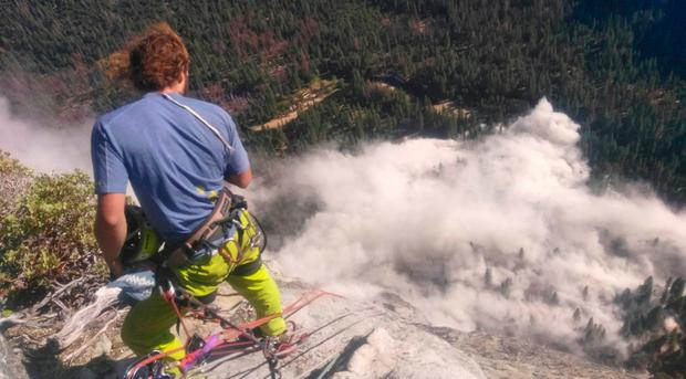 In this photo provided by Peter Zabrok, climber Ryan Sheridan who had just reached the top of El Capitan, a 7,569-foot (2,307 meter) formation, when a rock slide let loose below him. (Peter Zabrok via AP)