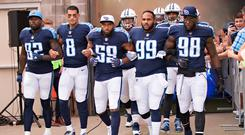 Delanie Walker #82, Marcus Mariota #8, Wesley Woodyard #59, Jurrell Casey #99 and Brian Orakpo #98 of the Tennessee Titans walk out of the tunnel with arms locked before a game against the Seattle Seahawks at Nissan Stadium on September 24, 2017 in Nashville, Tennessee. The Titans defeated the Seahawks 33-27. (Photo by Wesley Hitt/Getty Images)