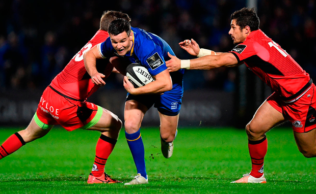 Jonathan Sexton of Leinster breaks through the tackles of James Johnstone, left, and Phil Burleigh of Edinburgh. Photo: Sportsfile