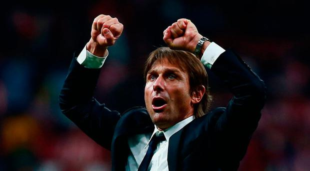 Antonio Conte celebrates Chelsea's win over AC Madrid on Wednesday Photo: Gonzalo Arroyo Moreno/Getty Images