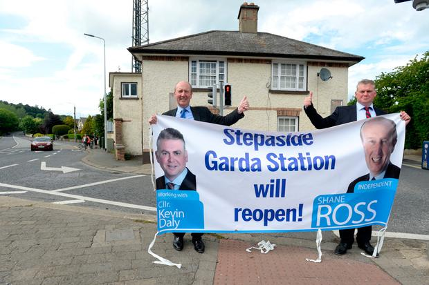 Transport Minister Shane Ross and Councillor Kevin Daly outside Stepaside Garda station. Photo: Justin Farrelly