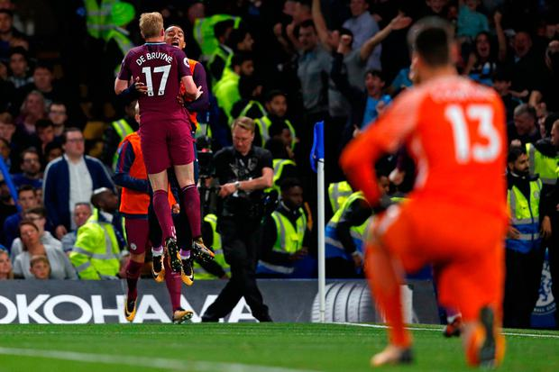 Chelsea goalkeeper Thibaut Courtois looks on as Manchester City's Belgian midfielder Kevin De Bruyne celebrates after scoring the only goal of the game at Stamford Bridge last night. Photo: Getty Images