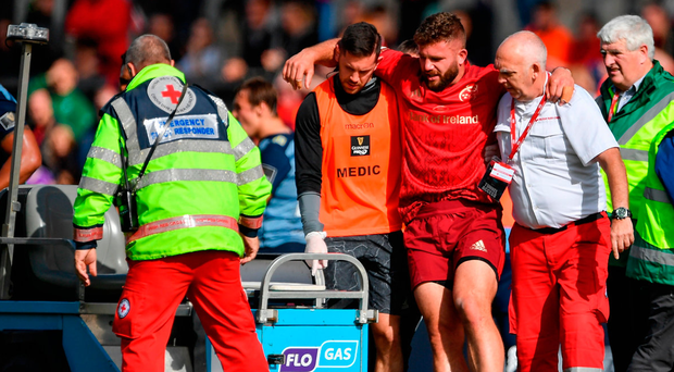 Jaco Taute is helped from the pitch after sustaining a injury Photo: Sportsfile