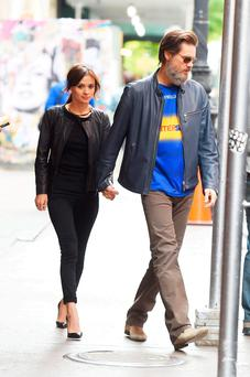 HAPPIER TIMES : Cathriona White and Jim Carrey pictured holding hands while walking in Manhattan after they got back together after initial split