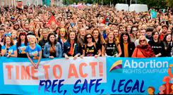 MILLENNIAL GENERATION: Demonstrators in their teens and twenties joined yesterday's march from the Garden of Remembrance to Merrion Square. Some in the crowd adapted the lyrics of pop songs as part of an impromptu choir called Voices for Choice. Photo: Gerry Mooney
