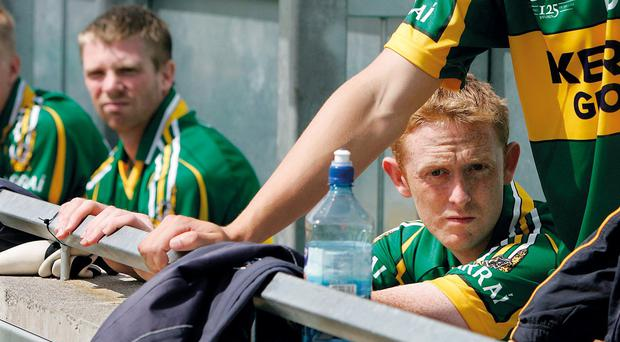 Tomas O'Se (5) and Colm 'Gooch' Cooper (13) on the bench at the start of the game against Antrim in 2009 ©INPHO/Morgan Treacy