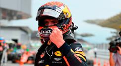 Red Bull's Dutch driver Max Verstappen celebrates winning the Formula One Malaysia Grand Prix in Sepang