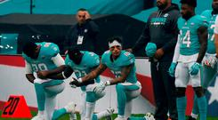 Miami Dolphins players kneel during the U.S. national anthem before the match. Action Images via Reuters/Paul Childs