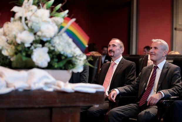 Same-sex couple Karl Kreil and Bodo Mende get married at a civil registry office, becoming Germany's first married gay couple after German parliament approved marriage equality in a historic vote this past summer, in Berlin, Germany October 1, 2017. REUTERS/Axel Schmidt