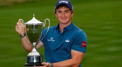 Ireland's Paul Dunne celebrates with the trophy after winning the British Masters