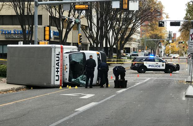 Edmonton Police investigate at the scene where a man hit pedestrians then flipped the U-Haul truck he was driving, pictured at the intersection at 107 Street and 100th Avenue in front of the Matrix Hotel in Edmonton, Alberta, Canada October 1, 2017. REUTERS/Candace Elliott