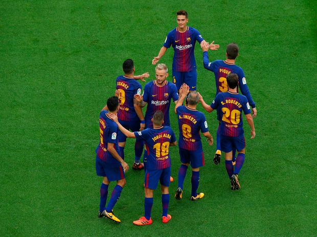 Barcelona's Sergio Busquets celebrates scoring their first goal with Jordi Alba, Ivan Rakitic and team mates