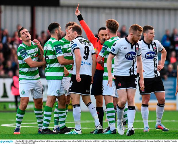 David McAllister of Shamrock Rovers receives a red card from referee Neil Doyle