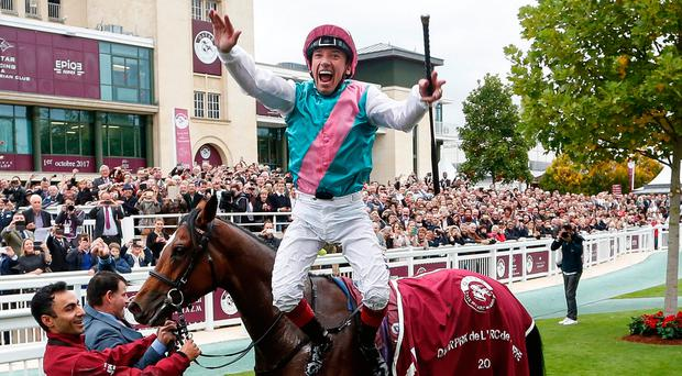 Frankie Dettori celebrates in trademark fashion after Enable's victory in the Prix de l'Arc de Triomphe. Photo by Alan Crowhurst/Getty Images