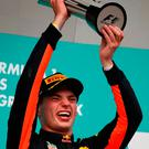 Race winner Max Verstappen celebrates on the podium. Photo by Clive Mason/Getty Images