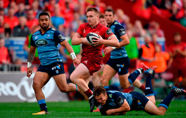 Rory Scannell of Munster breaks the tackle of Jarrod Evans of Cardiff Blues. Photo by Brendan Moran/Sportsfile