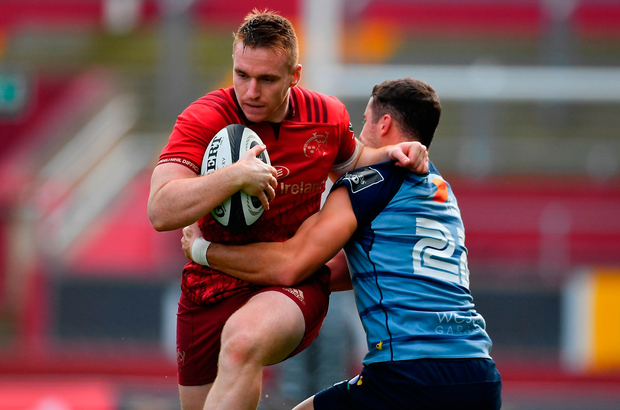 Rory Scannell of Munster is tackled by Steven Shingler of Cardiff Blues. Photo by Brendan Moran/Sportsfile