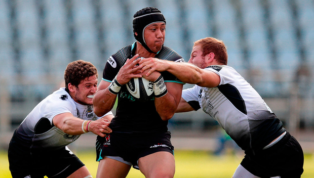 Christian Leali'ifano of Ulster is tackled by Marcello Violi and Giulio Bisegni of Zebre Rugby Club. Photo by Roberto Bregani/Sportsfile