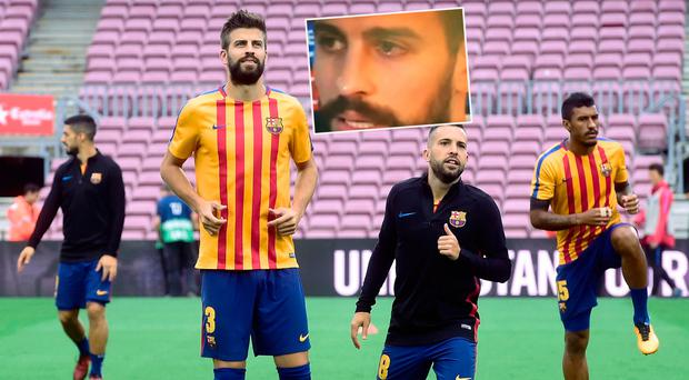 Gerard Pique warms up before Barca match on Sunday