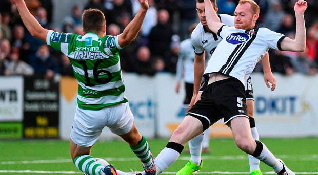 David McAllister goes over the top in his tackle on Dundalk's Chris Shields, earning the Shamrock Rovers man a red card. Photo by Stephen McCarthy/Sportsfile