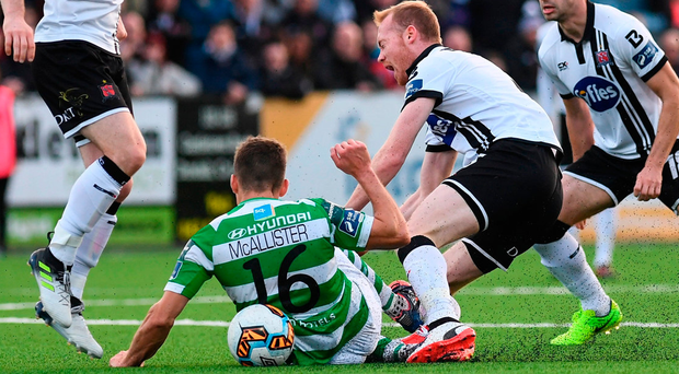 David McAllister puts in a tackle of Chris Shields, resulting in a red card for the Shamrock Rovers player. Photo by Stephen McCarthy/Sportsfile