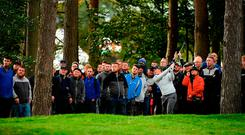 Paul Dunne hits his second shot on the 12th hole during the final day of the British Masters at Close House. Photo by Ross Kinnaird/Getty Images