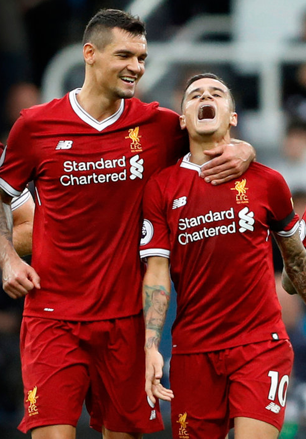 Philippe Coutinho is congratulated by Dejan Lovren after his goal for Liverpool
