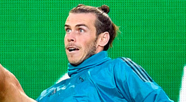 Bale is still recovering from a calf problem that has raised fears about his fitness. Credit: AP Photo/Martin Meissner
