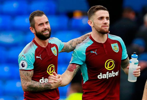 Burnley's Robbie Brady (r) and Steven Defour celebrate after the away win over Everton