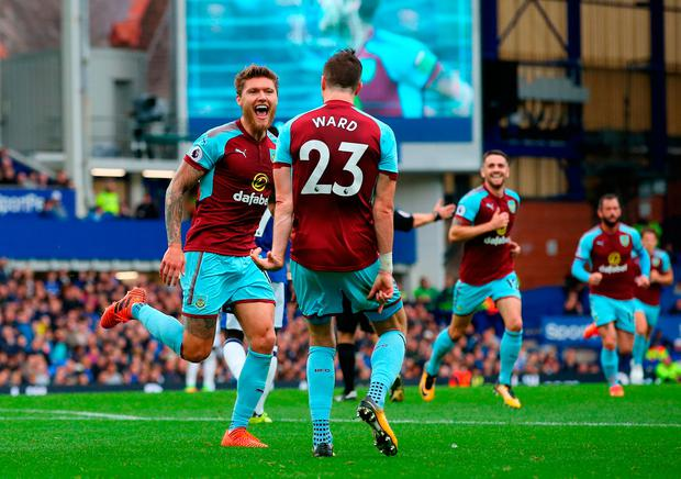 Jeff Hendrick celebrates scoring the winning goal for Burnley against Everton yesterday with his Ireland team-mate Stephen Ward. Photo by Alex Livesey/Getty Images