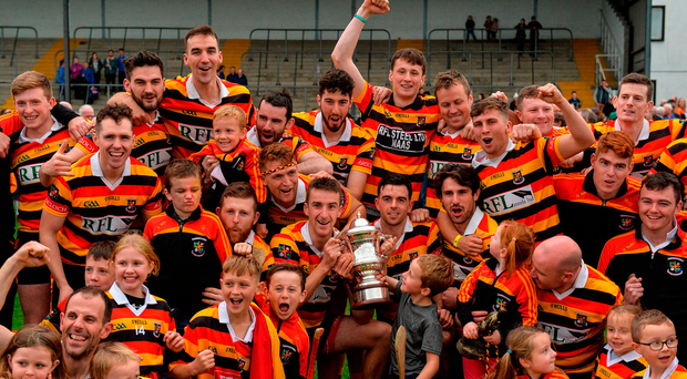 Ardclough players and supporters celebrate with The Tony Carew Cup after winning the Kildare SHC title. Photo: Sportsfile