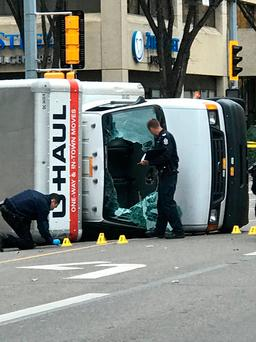 Police investigate the rented van that was flipped on its side while driven by the assailant in Edmonton. Photo: Reuters/Candace Elliott