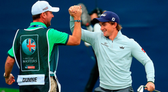 Ireland's Paul Dunne celebrates with his caddie Darren Reynolds after chipping in on the 18th hole to win the British Masters at Close House Golf Club. Photo: Getty Images