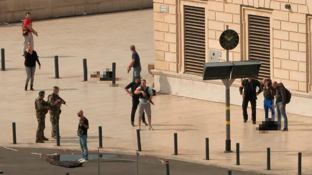 Police, soldiers, victim and assailant are seen on the site of the attack at Saint-Charles station in Marseille. Picture: Paul-Louis Leger/NEWZULU/via REUTERS