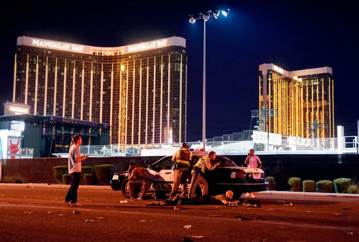 Las Vegas police stand guard along the streets outside the festival grounds of the Route 91 Harvest on October 1, 2017 in Las Vegas, Nevada. (Photo by David Becker/Getty Images)