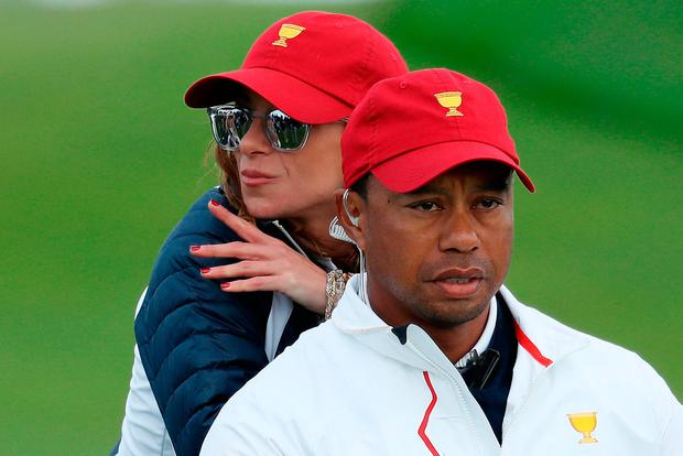 Tiger Woods of the U.S. Team and Erica Herman lok on during Saturday four-ball matches of the Presidents Cup at Liberty National Golf Club on September 30, 2017 in Jersey City, New Jersey. (Photo by Rob Carr/Getty Images)